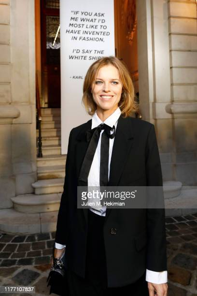 "Eva Herzigova attends the ""Tribute to the Karl Lagerfeld The White Shirt Project"" exhibition as part of Paris Fashion Week in Paris on September 25..."