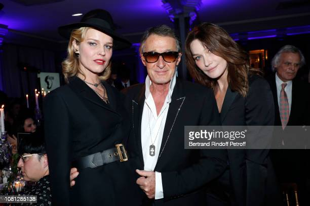 Eva Herzigova Eric Pfrunder and Carla BruniSarkozy attend the Annual Charity Dinner hosted by the AEM Association Children of the World for Rwanda at...