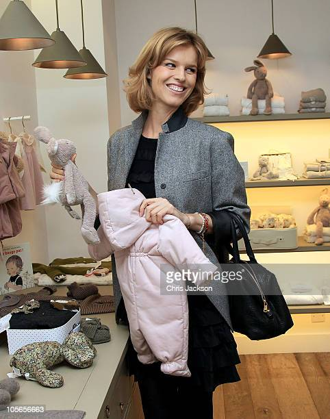 Eva Herzigova looks at children's clothes at the Bonpoint store on October 18 2010 in London England Eva Herzigova is pregnant with her second child...