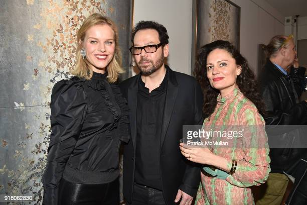 Eva Herzigova Neil Grayson and Yelena Yemchuk attend Neil Grayson Industrial Melanism solo exhibition at Eykyn Maclean Gallery on February 13 2018 in...