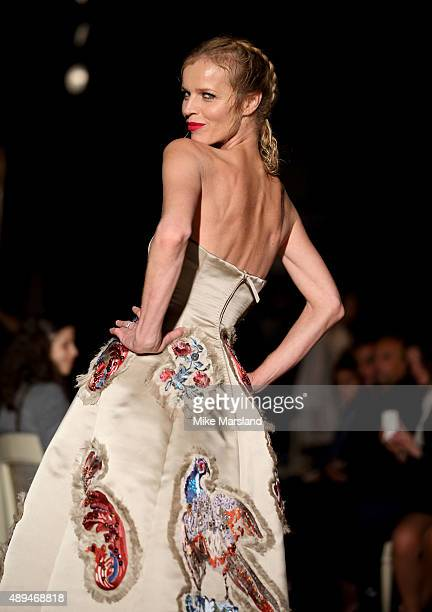 Eva Herzigova walks the runway at the GILES show during London Fashion Week Spring/Summer 2016/17 on September 21 2015 in London England