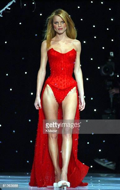 Eva Herzigova wearing red Victoria's Secret custom corset and red Victoria's Secret second skin satin thong