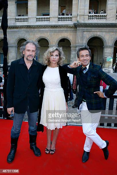 Eva Ionesco standing between her husband Journalist Simon Liberati and Sets and Costumes of the Opera Vincent Darre attend 'La Traviata' Opera en...