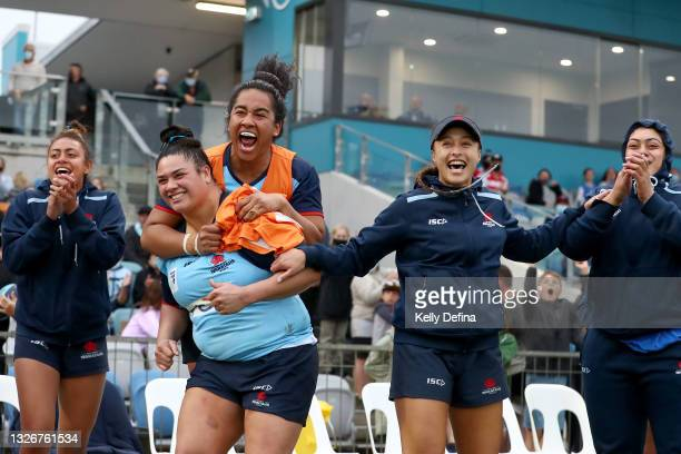 Eva Karpani of the Waratahs and Adiana Talakai of the Waratahs react with team mates during the Super W Final match between the NSW Waratahs and the...