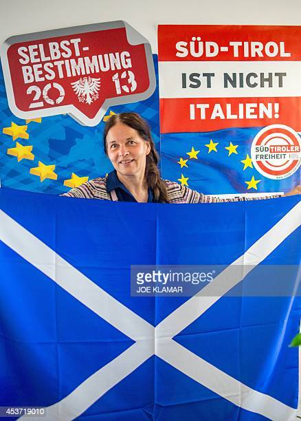 Eva Klotz of SuedTiroler Freiheit party displays a Scotish flag in the party's headquarters on June 26 2014 in the city of Bolzano /Bozen in South...
