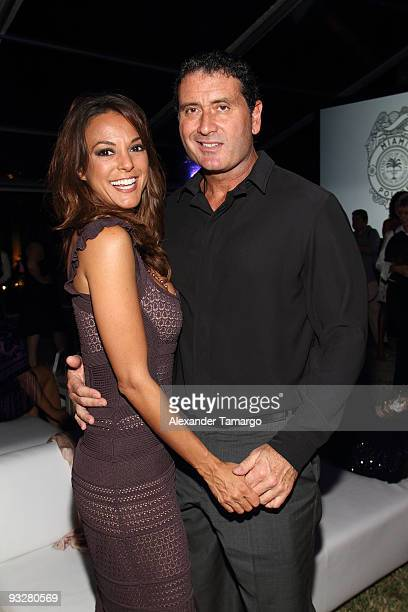 Eva La Rue and Joe Capuccio pose inside at The Rally for Kids with Cancer Celebrity Draft Party on November 20 2009 in Miami Beach Florida