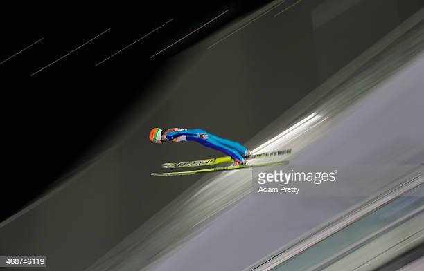 Eva Logar of Slovenia jumps during the Ladies' Normal Hill Individual first round on day 4 of the Sochi 2014 Winter Olympics at the RusSki Gorki Ski...