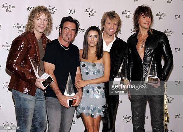 Eva Longoria and Bon Jovi during 32nd Annual American Music Awards Press Room at Shrine Auditorium in Los Angeles California United States