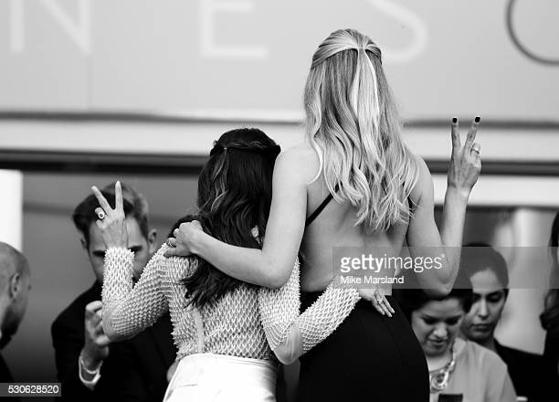 Eva Longoria and Doutzen Kroes attend the 'Cafe Society' premiere and the Opening Night Gala during the 69th annual Cannes Film Festival at the...