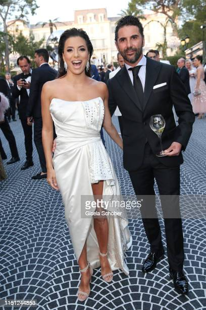 Eva Longoria and Jose Baston attend the amfAR Cannes Gala 2019 at Hotel du CapEdenRoc on May 23 2019 in Cap d'Antibes France
