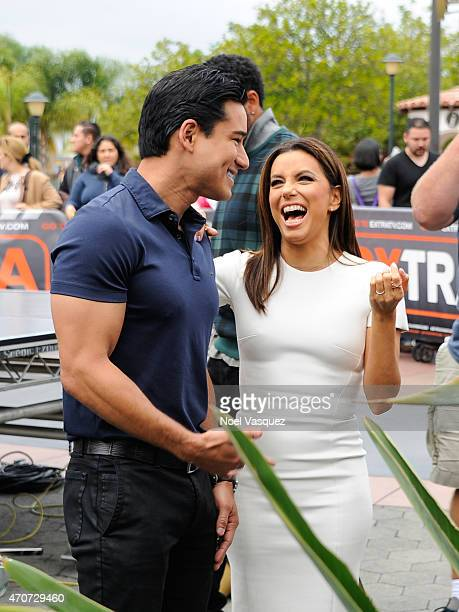 Eva Longoria and Mario Lopez visit 'Extra' at Universal Studios Hollywood on April 22 2015 in Universal City California