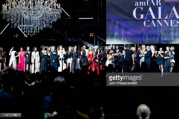 Eva Longoria and models are seen on stage during the amfAR Cannes Gala 2019 at Hotel du CapEdenRoc on May 23 2019 in Cap d'Antibes France