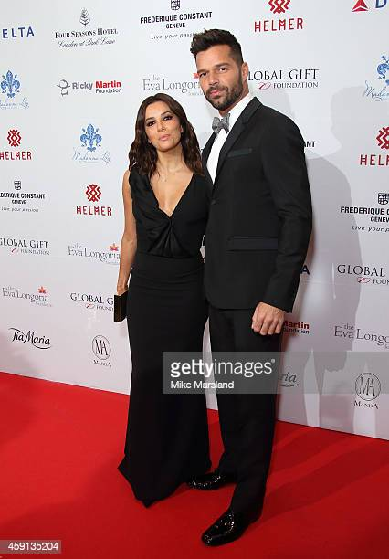 Eva Longoria and Ricky Martin attend the Global Gift Gala at Four Seasons Hotel on November 17 2014 in London England