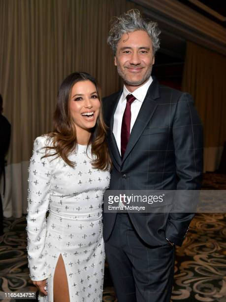 Eva Longoria and Taika Waititi attend the cocktail reception during Hollywood Foreign Press Association's Annual Grants Banquet at Regent Beverly...