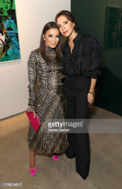 Eva Longoria and Victoria Beckham attend Victoria Beckham and Sotheby's celebration of Andy Warhol with Don Julio 1942 at her Dover Street store on...