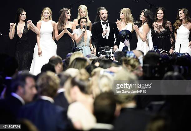 Eva Longoria, designer Tom Ford, and models onstage during the fashion show runway during amfAR's 22nd Cinema Against AIDS Gala, Presented By Bold...