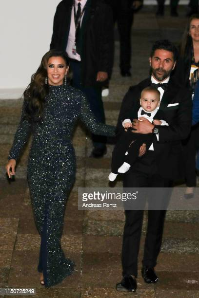 Eva Longoria her husband Jose Baston and their son Santiago Enrique Baston attend the The Global Gift Initiative event during the 72nd annual Cannes...