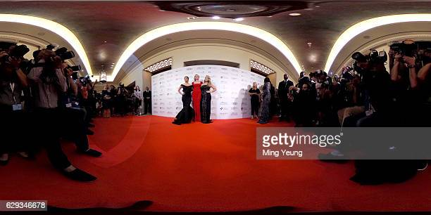 Eva Longoria Melanie Griffith and Anastacia pose for photographers at the Global Gift Gala during day six of the 13th annual Dubai International Film...