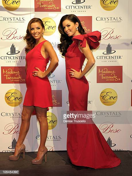 Eva Longoria Parker poses with photos with the Madame Tussauds Eva Longoria Parker wax figure at Eve Nightclub at CityCenter on October 13 2010 in...