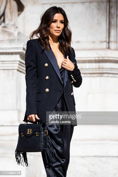 Eva Longoria wearing a black blazer black satin pants and Balmain bag and heels is seen outside the Balmain show during Paris Fashion Week Womenswear...