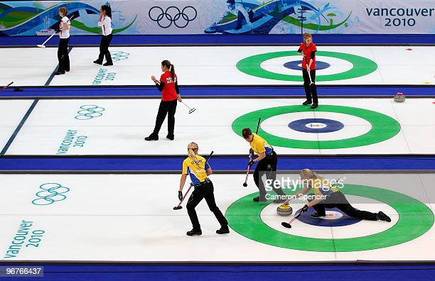 Eva Lund of Sweden releases the stone during the women's curling round robin game between Denmark and Sweden on day 5 of the Vancouver 2010 Winter...