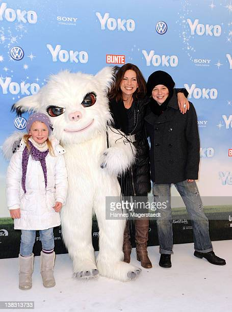 Eva Maehl and her kids Lauren und Sophia attend the Yoko Premiere at the Mathaeser Filmpalast on February 5 2012 in Munich Germany