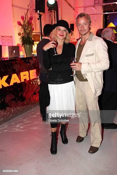 Eva Maria Grein von Friedl and husband Christoph von Friedl attend the grand opening of KARE Kraftwerk on October 9, 2014 in Munich, Germany.