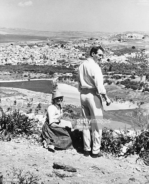 Eva Marie Saint and Paul Newman relax between scenes while Exodus on a hill overlooking the town of Kfar Kana