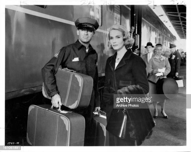 Eva Marie Saint helps a disguised Cary Grant elude the police in a scene from the film 'North By Northwest' 1959