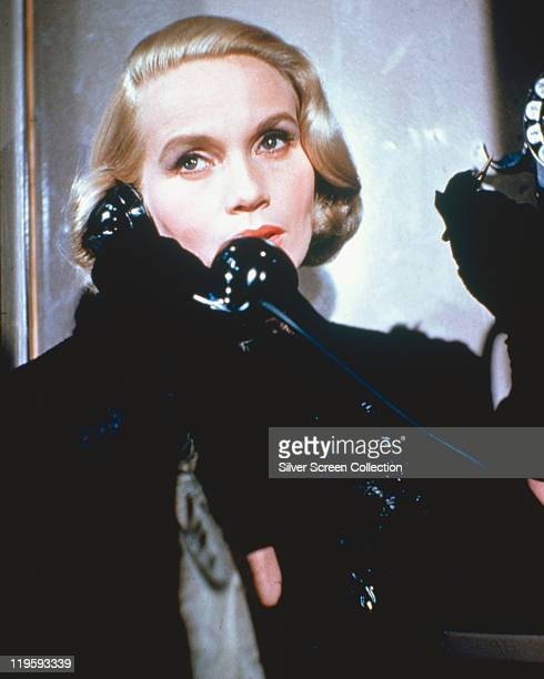 Eva Marie Saint US actress wearing a black coat with black gloves while holding a telephone receiver in a publicity image issued for the film 'North...