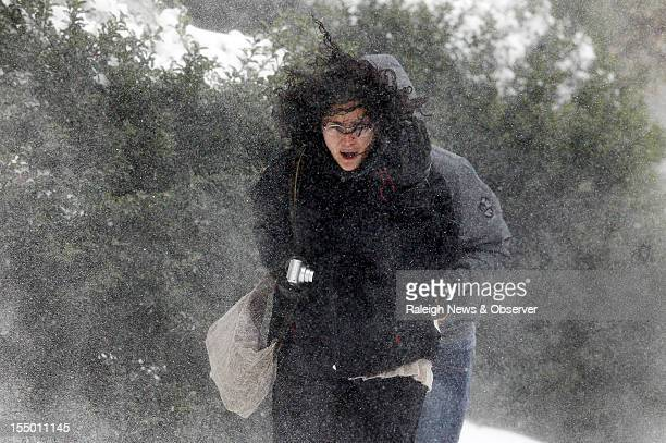 Eva Miranda battles through howling wind and snow as she makes her way across the campus at Appalachian State University on Tuesday October 30 2012...