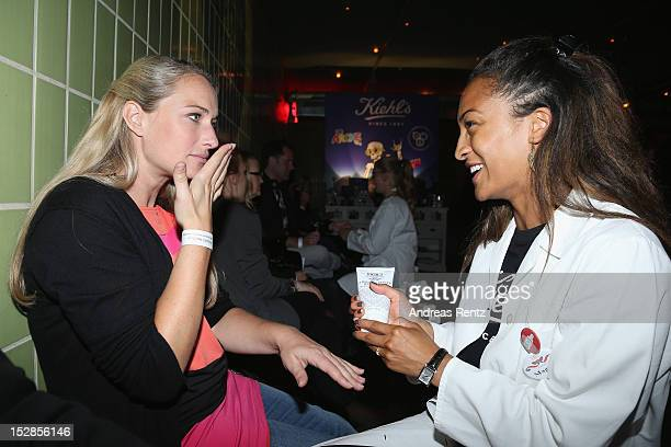 Eva Mona Rodekirchen receives a hand massage during the Kiehl's Rocktour charity event in aid of 'Die Arche' on September 27 2012 in Berlin Germany