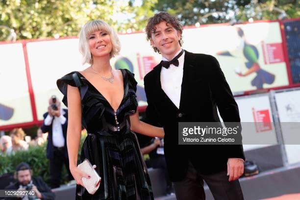 Eva Nestori and Festival Host Michele Riondino walk the red carpet ahead of the Award Ceremony during the 75th Venice Film Festival at Sala Grande on...