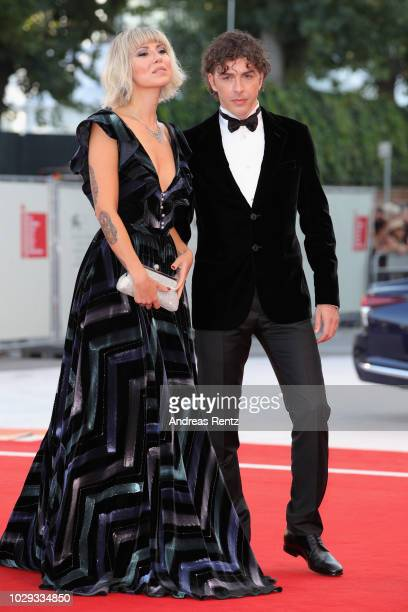 Eva Nestori and Festival Host Michele Riondino walk the red carpet ahead of the Award Ceremony during the 75th Venice Film Festival at Sala Grande on...