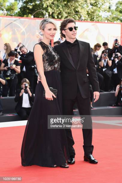 Eva Nestori and Michele Riondino walk the red carpet ahead of the opening ceremony and the 'First Man' screening during the 75th Venice Film Festival...