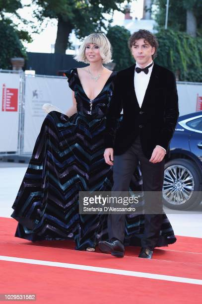 Eva Nestori and Michele Riondino walk the red carpet ahead of the Award Ceremony during the 75th Venice Film Festival at Sala Grande on September 8...