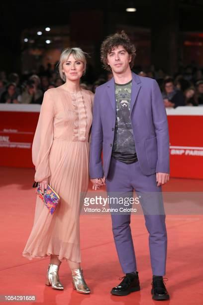 "Eva Nestori and Michele Riondino walk the red carpet ahead of the ""Notti Magiche"" screening during the 13th Rome Film Fest at Auditorium Parco Della..."