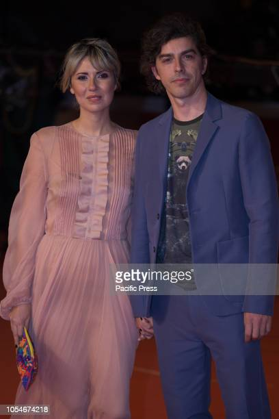 Eva Nestori and Michele Riondino walk the red carpet ahead of the 'Notti Magiche' screening during the 13th Rome Film Fest