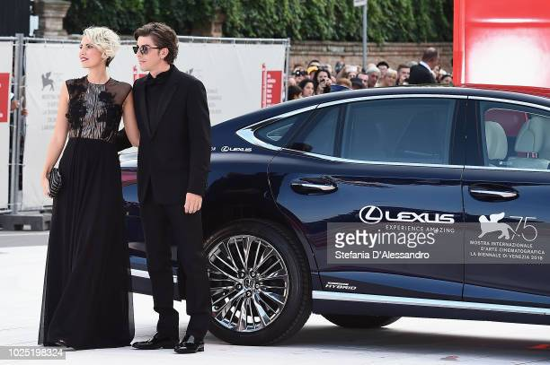 Eva Nestori and Michele Riondino walks the red carpet ahead of the opening ceremony and the 'First Man' screening during the 75th Venice Film...