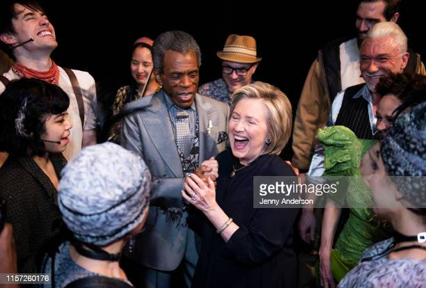 """Eva Noblezada, Reeve Carney, André De Shields, Hillary Clinton, Patrick Page and the cast of """"Hadestown"""" backstage at the Walter Kerr Theatre on June..."""