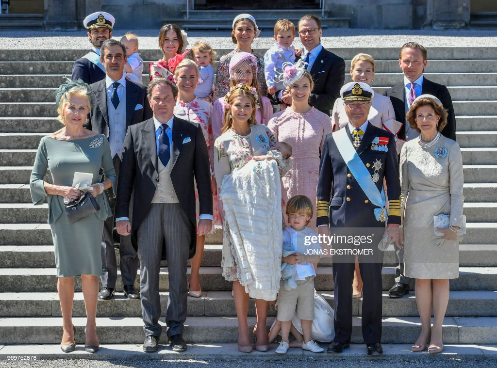 Eva O'Neill, Mr Christopher O'Neill, princess Madeleine with princess Adrienne of Sweden, prince Nicolas of Sweden, king Carl Gustaf of Sweden and queen Silvia of Sweden, (Second row left to right) God parents Nader Panahpour, Charlotte Kreuger Cederlund, Anouska D'Abo, Coralie Charriol Paul, Natalie Werner and Gustav Thott, (Third row left to right) Prince Carl Philip of Sweden with prince Gabriel of Sweden, princess Sofia of Sweden, with prince Alexander of Sweden, crown princess Victoria of Sweden and prince Daniel of Sweden with prince Oscar pose during a family picture of the royal family and the godparents after princess Adrienne's christening ceremony in Drottningholm Palace Chapel in Stockholm, Sweden on June, 8 2018. - Princess Adrienne is princess Madeleine's and Mr Christopher O'Neill's third child. (Photo by Jonas EKSTROMER / various sources / AFP) / Sweden OUT