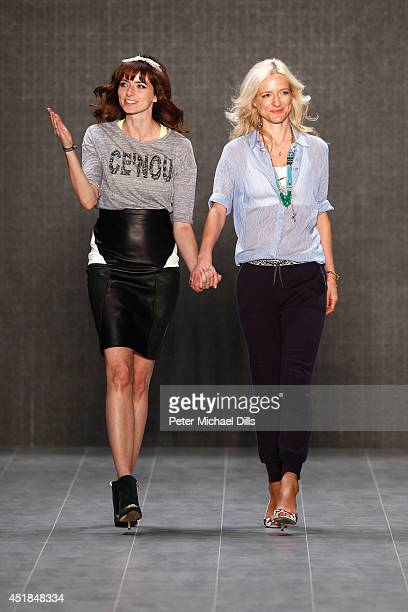Eva Padberg and Katja Will walk the runway after the C'est Tout / Ce' Nou show during the MercedesBenz Fashion Week Spring/Summer 2015 at Erika Hess...