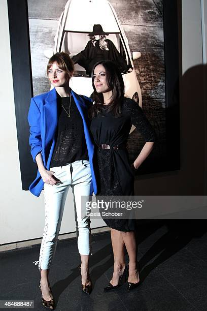 MUNICH GERMANY JANUARY Eva Padberg Bettina Zimmermann attend the presentation and vernissage of the calender 'THE ADAM BY BRYAN ADAMS' for Opel at...