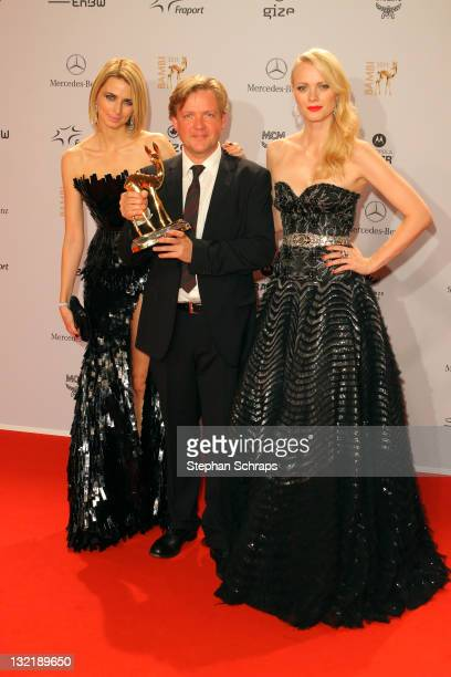 Eva Padberg Justus von Dohnanyi and Franziska Knuppe pose in front of the winners board during the Bambi Award 2011 ceremony at the RheinMainHallen...