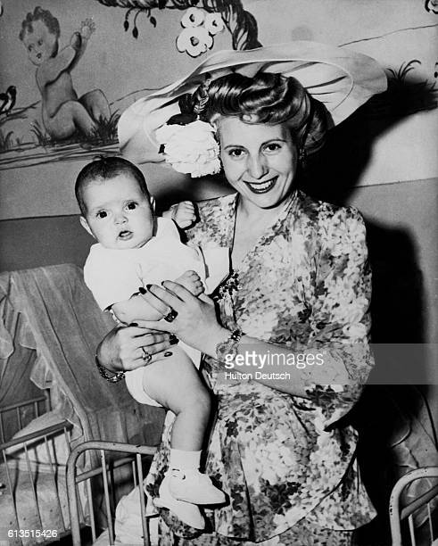 Eva Peron visits the Child Welfare Center in Rome and holds a patient