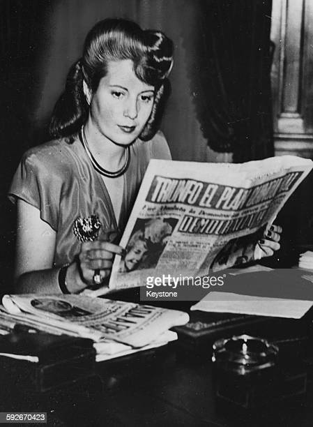 Eva Peron Wife of the President of Argentina reading a copy of the 'Democrazia' newspaper of which shwe is the owner April 1947