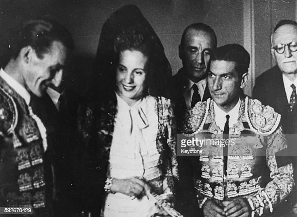 Eva Peron Wife of the President of Argentina talking to two bullfighters at a gala bullfight held in her honor Madrid June 15th 1947