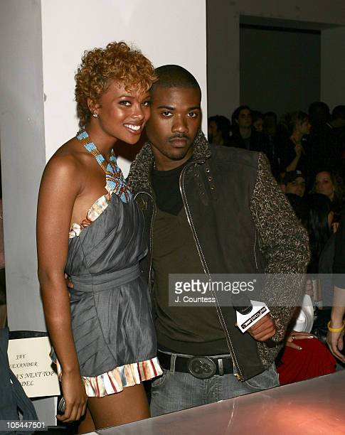 Eva Pigford and Ray J during Olympus Fashion Week Fall 2005 Baby Phat Front Row and Backstage at Skylight Studios in New York City New York United...