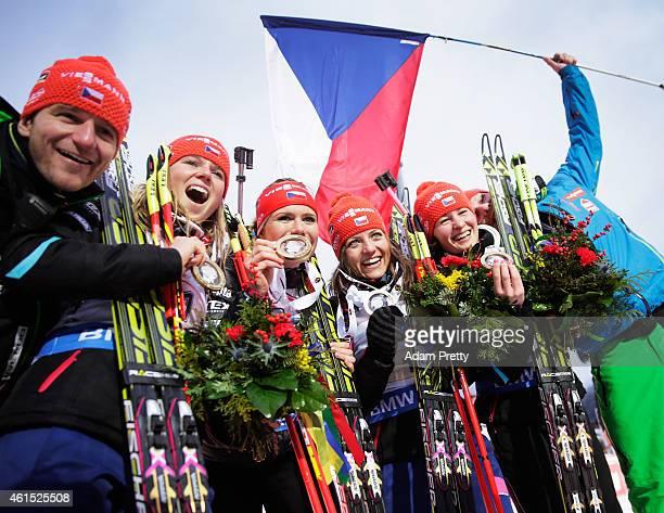 Eva Puskarcikova, Gabriela Soukalova, Jitka Landova and Veronika Vitkova of the Czech Rebublic celebrate victory in the IBU Biathlon World Cup...