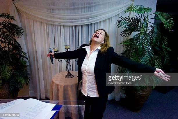Eva Rodriguez rejoices as the congregation sings at the Christian Worship Center/Centro Cristiano de Adoracion April 5 in Sacramento California Her...